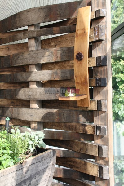 Privacy fence from former whiskey barrel staves